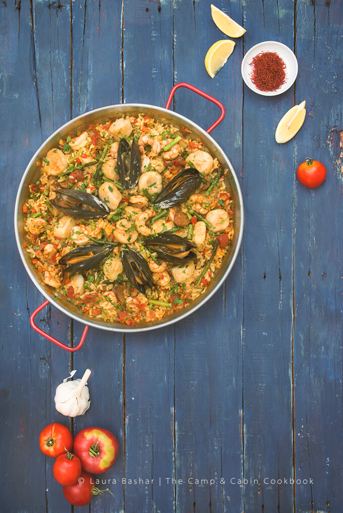 Overhead shot of campfire paella by Laura Bashar from the Camp & Cabin Cookbook -- FamilySpice.com