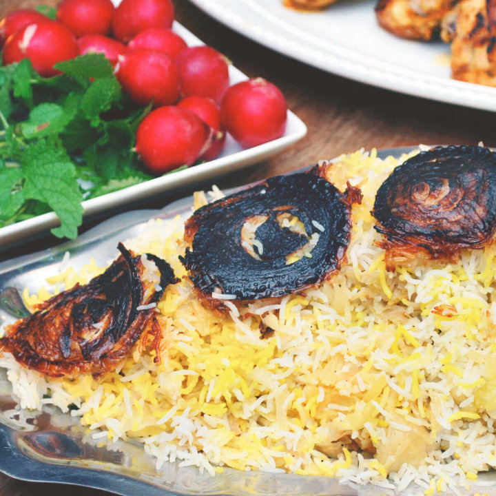 A platter of basmati rice with saffron, cabbage and fried onion crust by FamilySpice.com