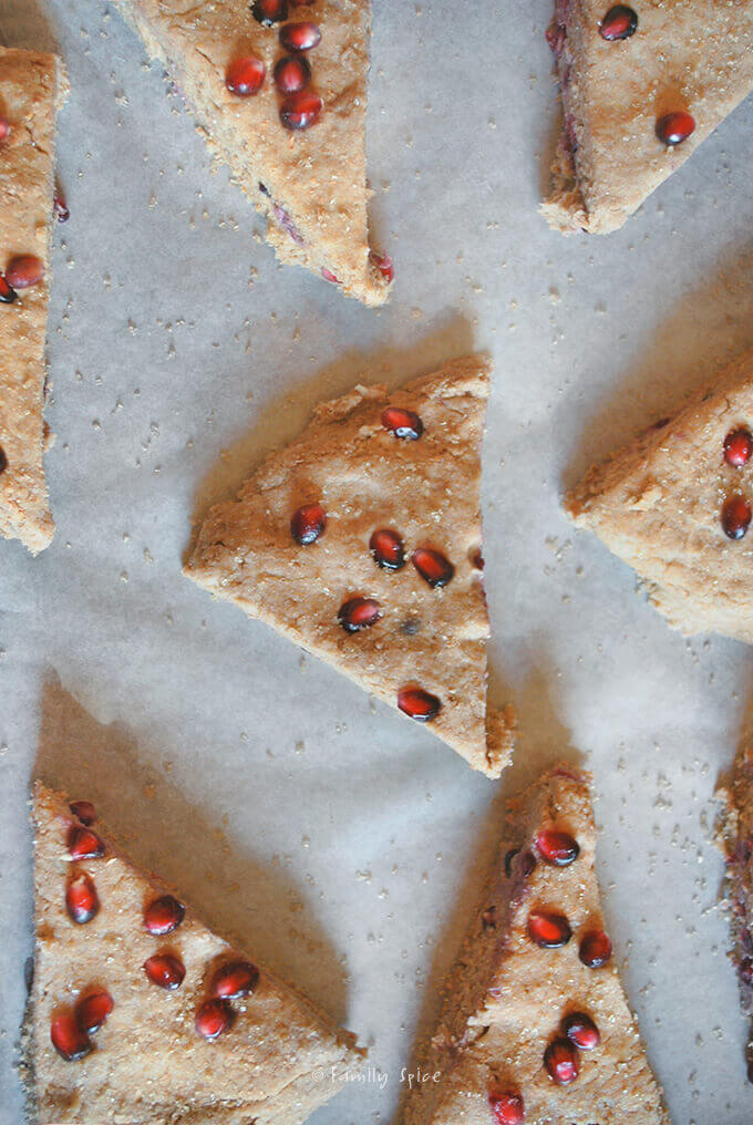 Yogurt whole wheat scones with pomegranate cut into wedges and ready to bake by FamilySpice.com