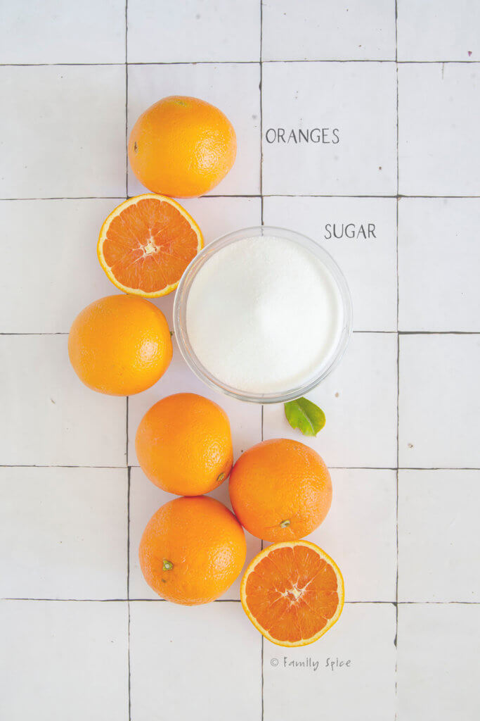 Ingredients labeled and needed to make orange marmalade (orange jam)