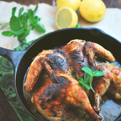 This Spatchcocked Chicken with Mint and Garlicis marinated with mint, lemon zest and garlic and roasted in a cast iron pan for a quick and easy meal for any day of the week. -- FamilySpice.com