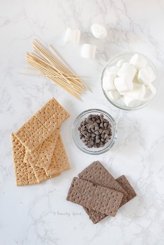Overhead shot of ingredients needed to make s'mores on a stick by FamilySpice.com