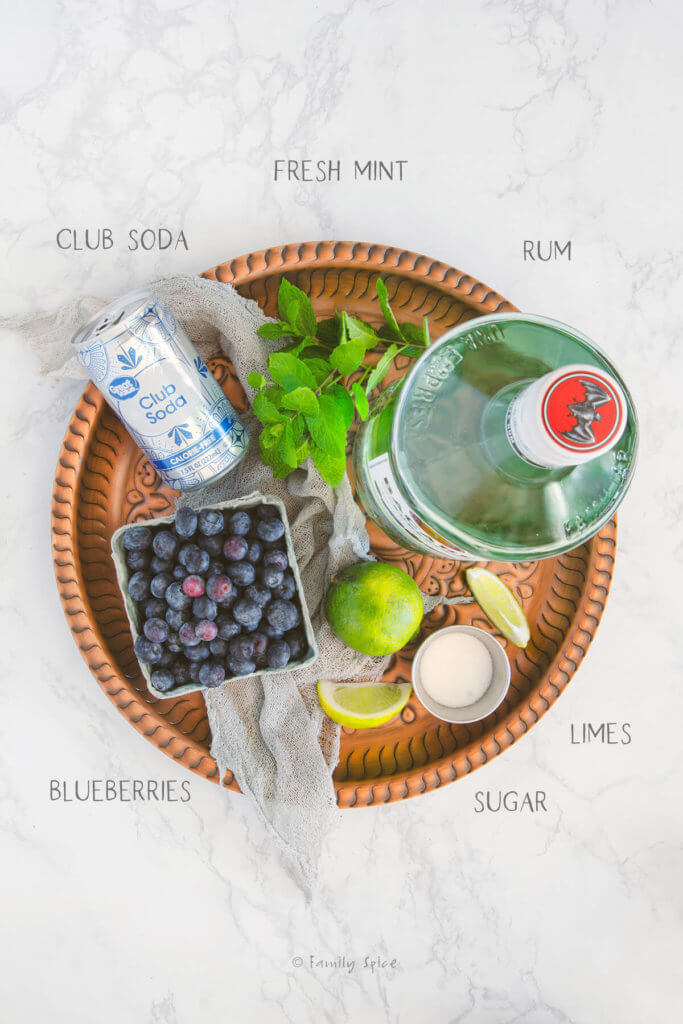 Ingredients labeled and needed to make blueberry mojito