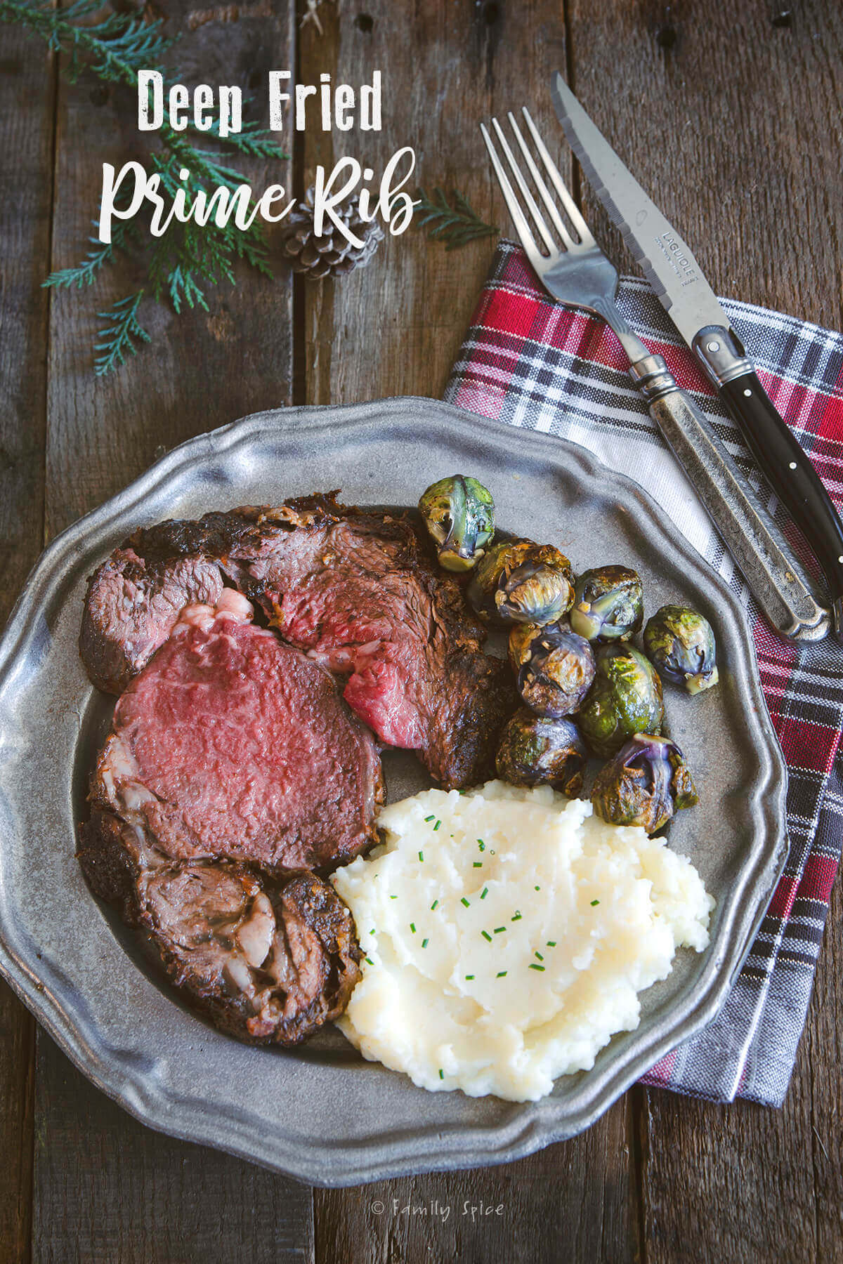 A plate of a slice of deep fried prime rib with mashed potatoes and Brussels sprouts by FamilySpice.com