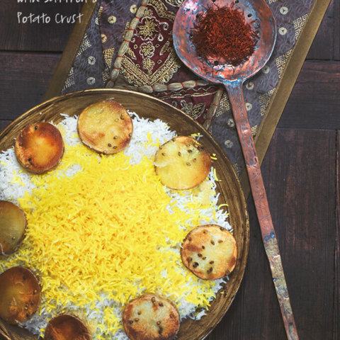 A round tray filled with Persian Basmati Rice with Saffron and Potato Crust -- by FamilySpice.com