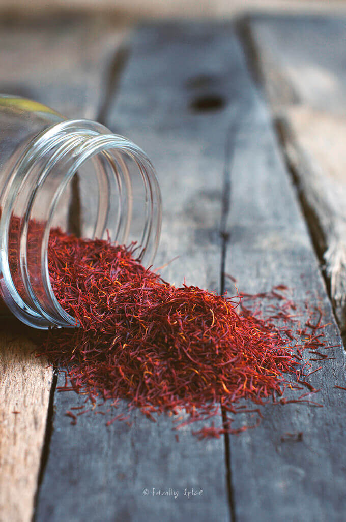 small jar of spilled saffron threads by FamilySpice.com