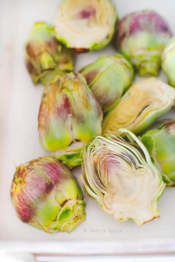 Baby artichokes cleaned and halved before braising by FamilySpice.com