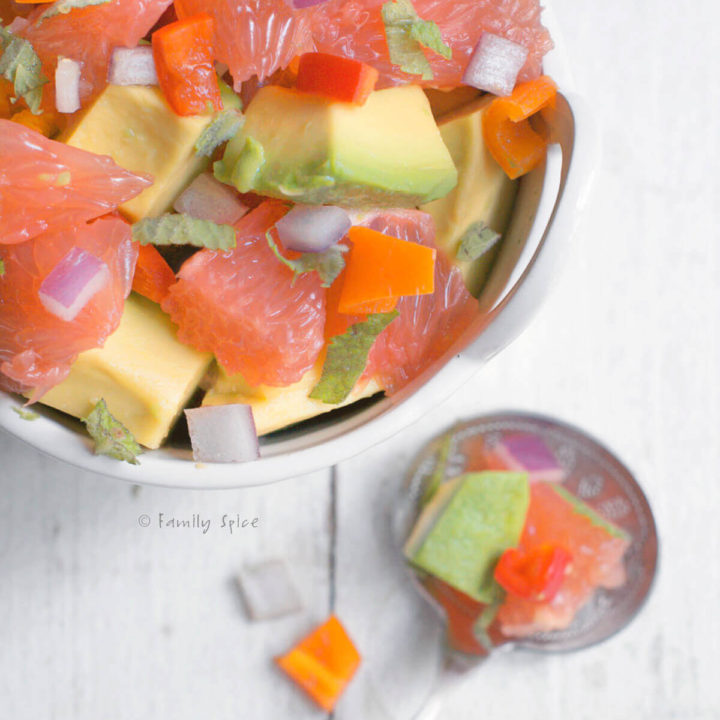 Top view of a small white bowl with avocado grapefruit salad