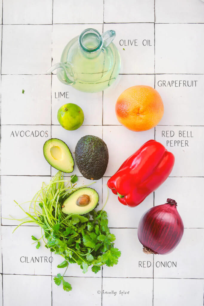 Ingredients needed and labeled to make avocado grapefruit salad