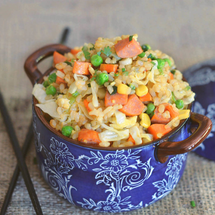 Closeup of fried brown rice with carrots, corn, peas and sausage by FamilySpice.com
