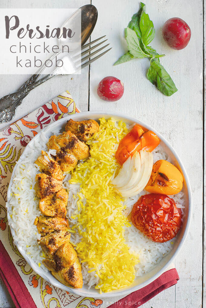 Over head shot of a plate full of Persian Chicken Kabob (Joojeh Kabob or Kabob-eh Morgh) with basmati rice by FamilySpice.com