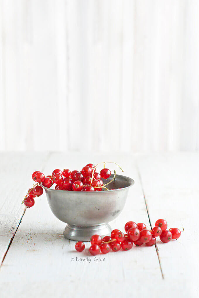 Ruby red currants in a pewter bowl by FamilySpice.com