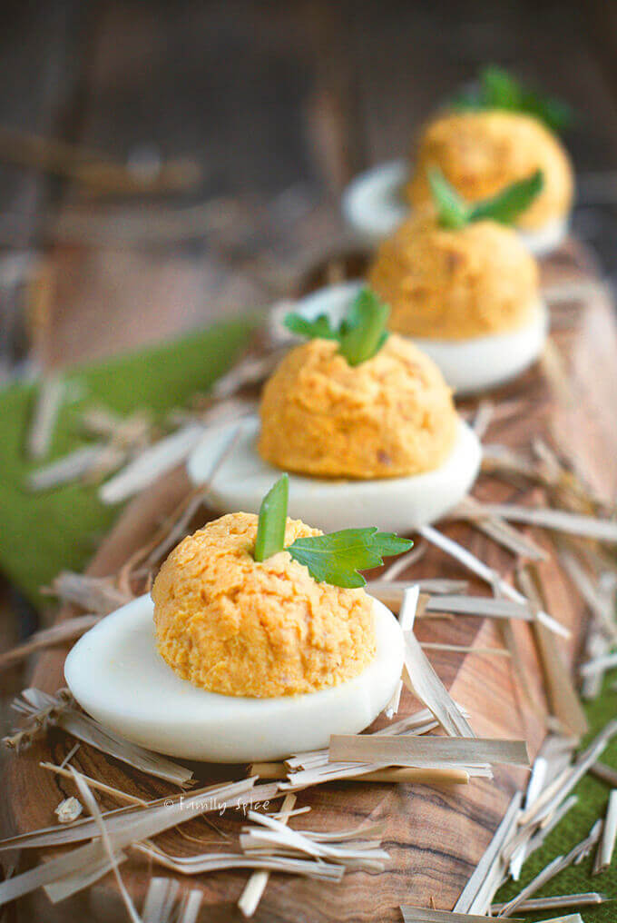 Closeup of some ham and pumpkin deviled eggs by FamilySpice.com