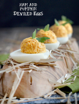 A row of festive ham and pumpkin deviled eggs by FamilySpice.com