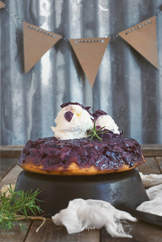 Black grape upside down cake with vanilla ice cream on top by FamilySpice.com