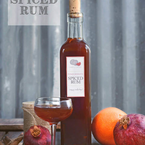 A bottle of pomegranate spiced rum with oranges by FamilySpice.com