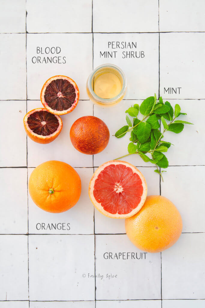 Ingredients needed and labeled to make citrus salad