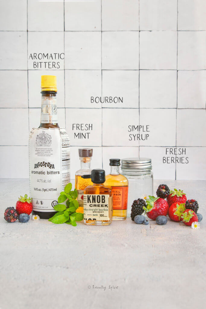 Ingredients labeled and needed for berry bourbon smash