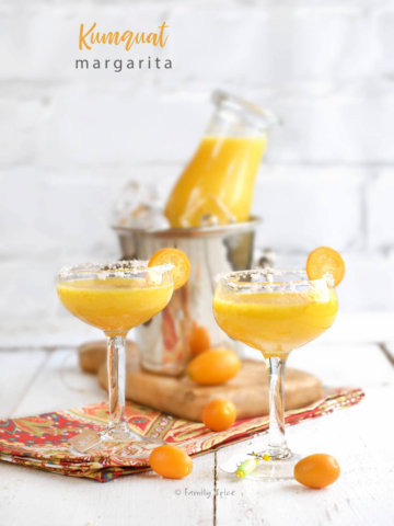 Small stemware filled with kumquat margaritas by FamilySpice.com