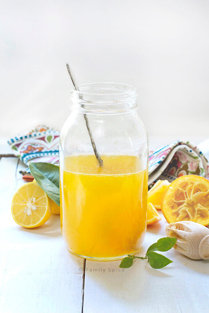 A large bottle filled with Persian Bitter Orange Syrup (Sharbat-e Porteghal) by FamilySpice.com