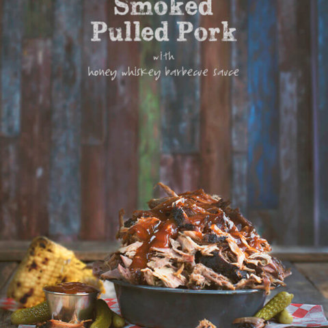 A pile of smoked pulled pork topped with honey whiskey barbecue sauce by FamilySpice.com