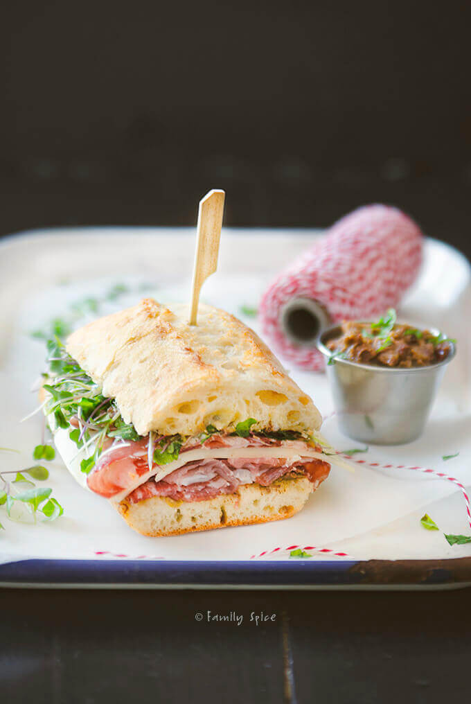 Closeup of an Italian grinder submarine sandwich with olive tapenade by FamilySpice.com