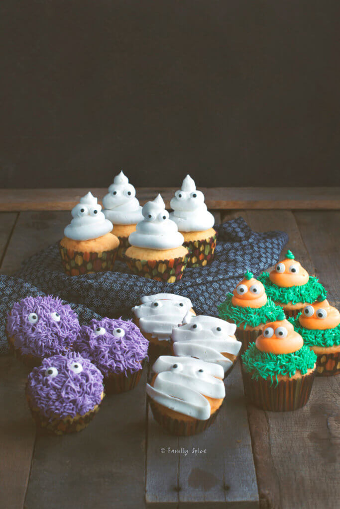 Assortments of halloween cupcakes on a dark rustic background