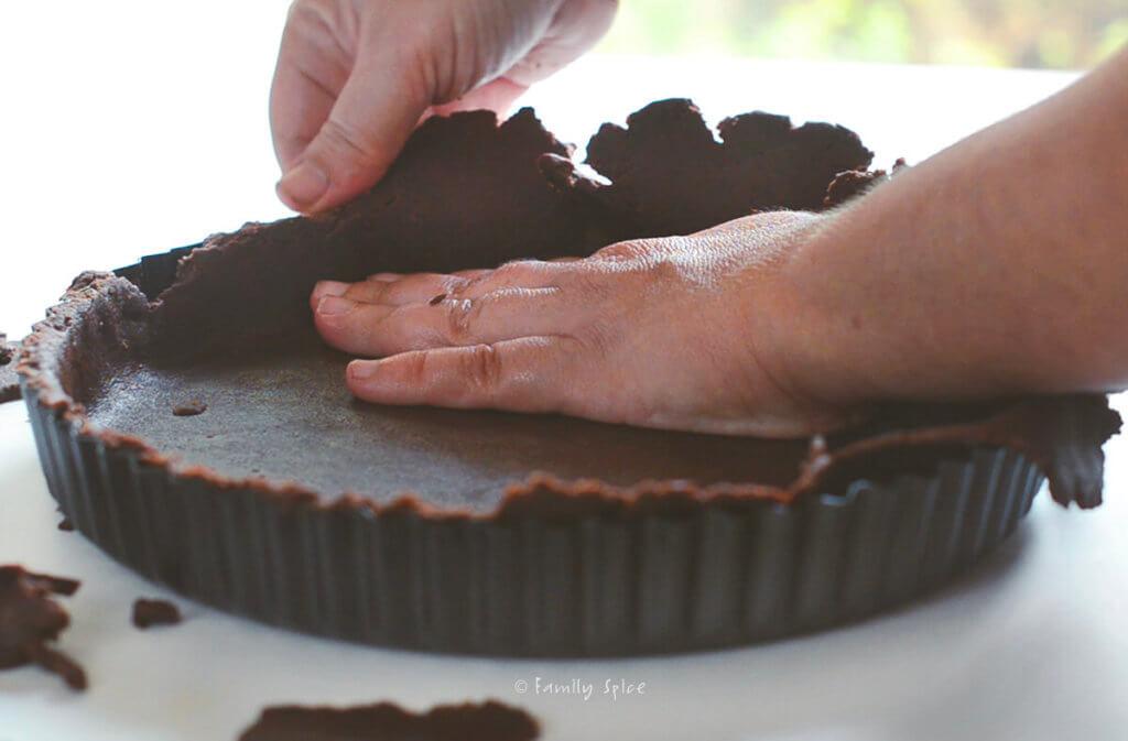 Pressing chocolate pie dough into pan