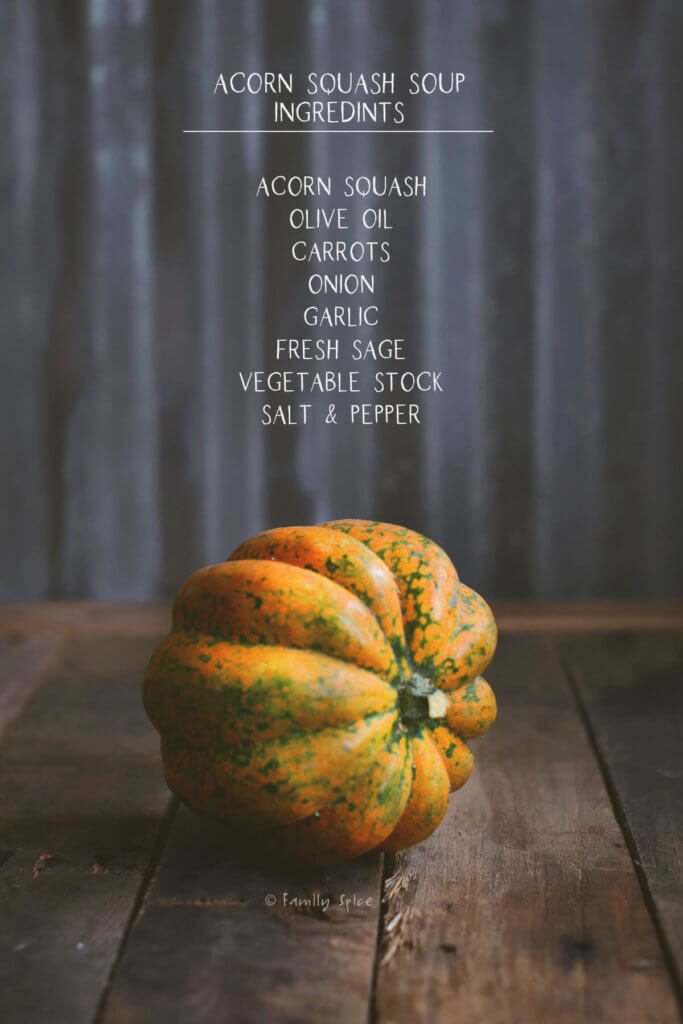 Image of acorn squash on rustic background with ingredients to make acorn squash soup listed
