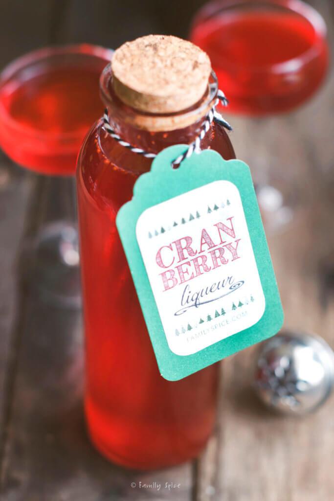 Closeup of a bottle of cranberry liqueur with a label