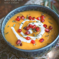 Roasted Acorn Squash Soup with Sage, Pomegranate and Sour Cream