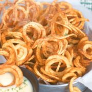 pinterest image for curly fries with beer cheese