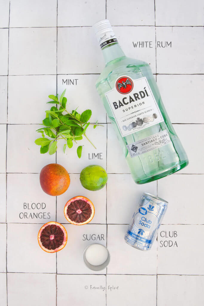 Ingredients needed and labeled to make blood orange mojito