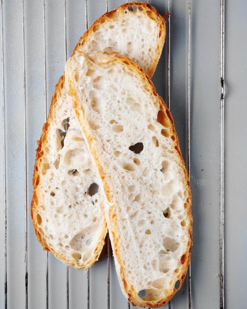 Sliced bread on cooling rack