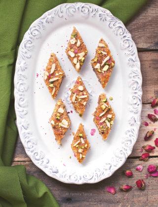 Overhead shot of a plate holding diamond shaped Persian baklava cake