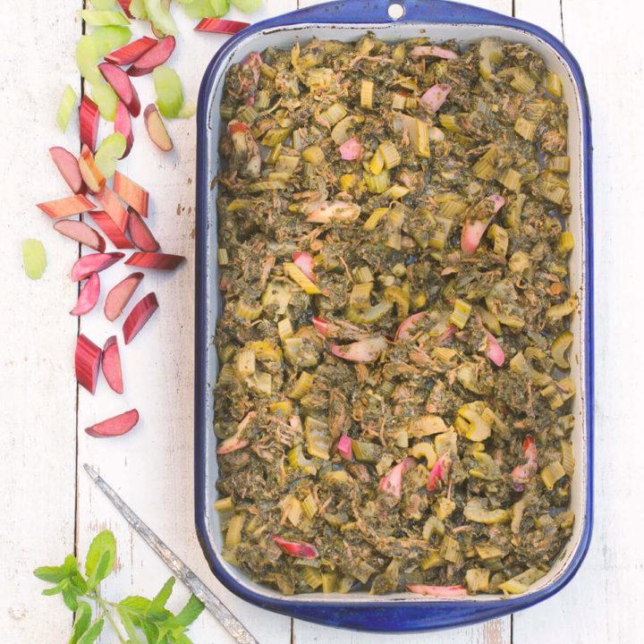 Top view of an enamel serving dish with khoresht karafs ba rivas (Persian celery stew)