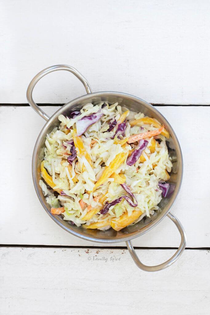 A metal dish with mango cole slaw