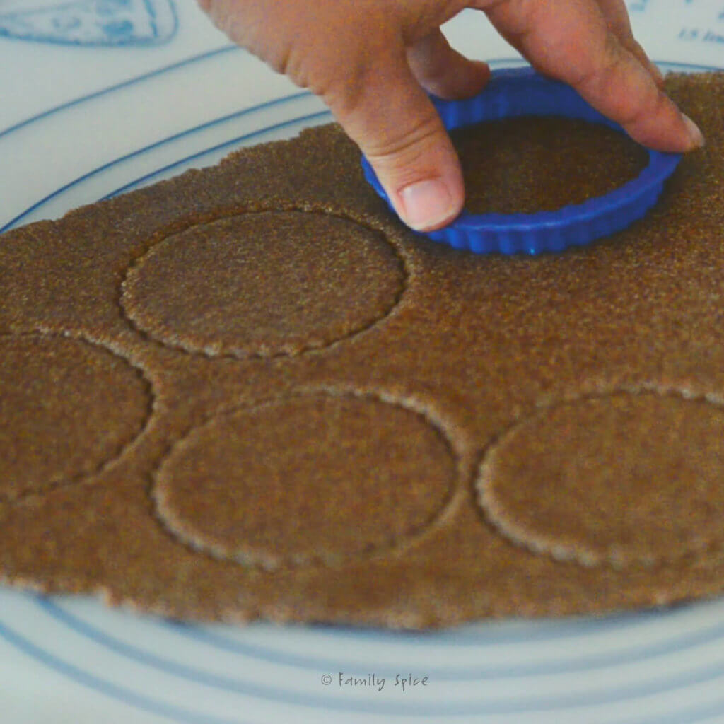 Cutting cookie rounds from flattened cookie dough