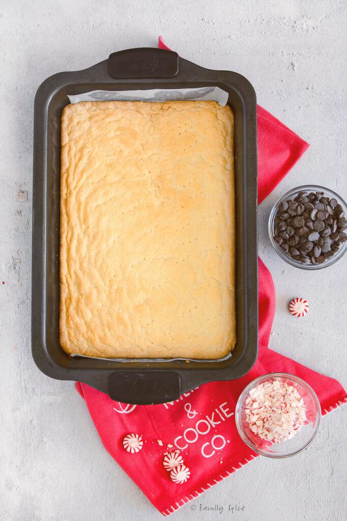 Shortbread cookie batter freshly baked in a 9x13 metal pan