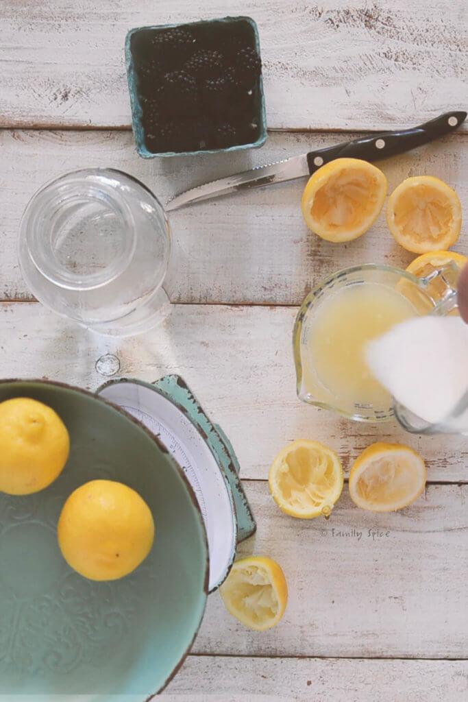 Adding sugar to lemon juice mixture