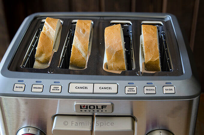 Toast getting toasted in a WOLF toaster by FamilySpice.com