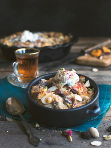 A small black bowl with om ali (Egyptian bread pudding) in it