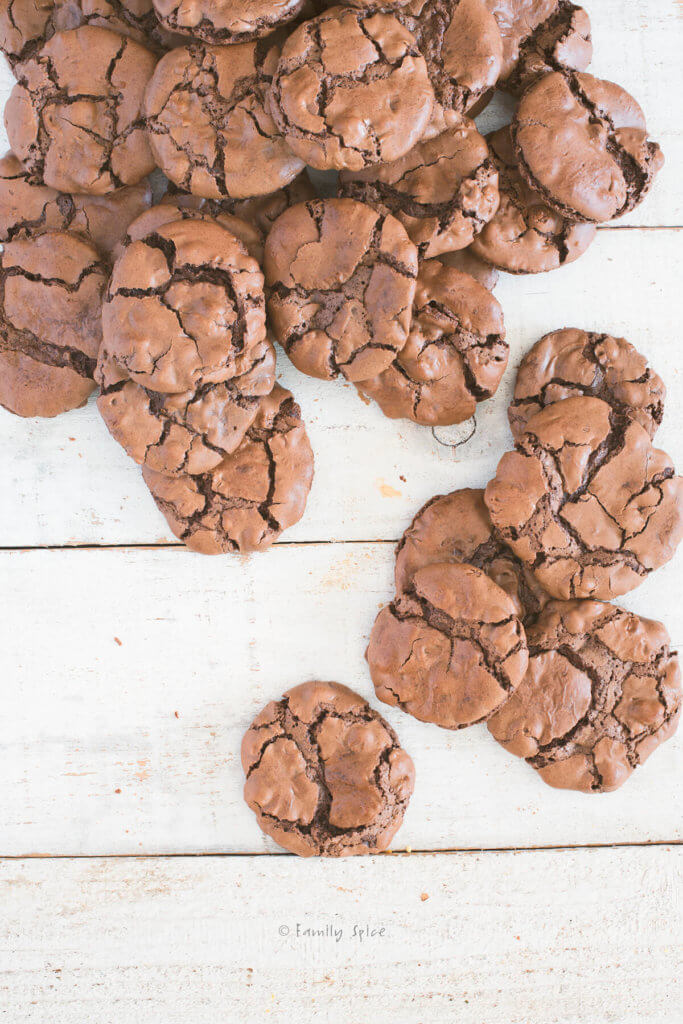 Close up of a top view of a white table covered in brownie cookies