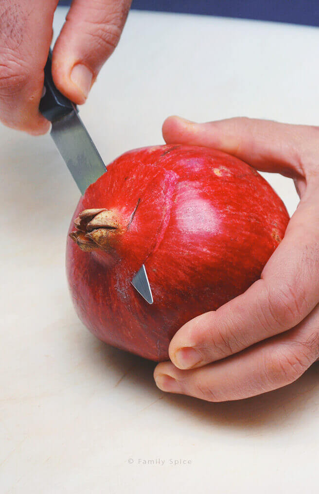 Removing the crown off the pomegranate by FamilySpice.com