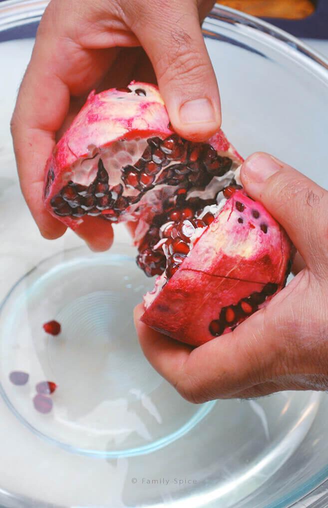 Cutting open a pomegranate by FamilySpice.com