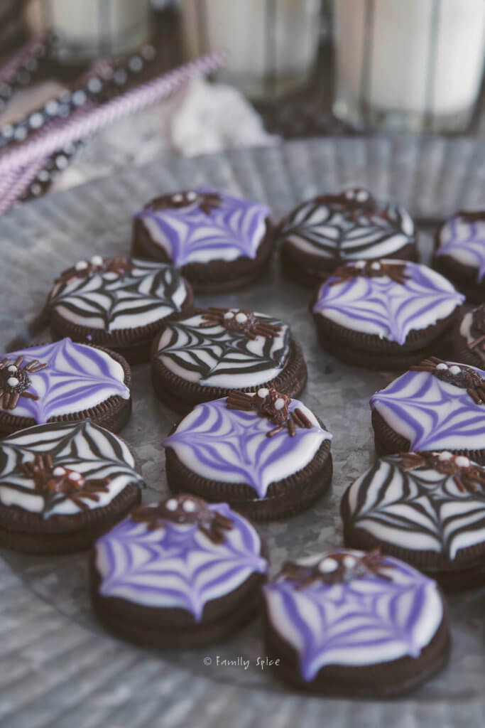 Closeup of purple and black spider cookies