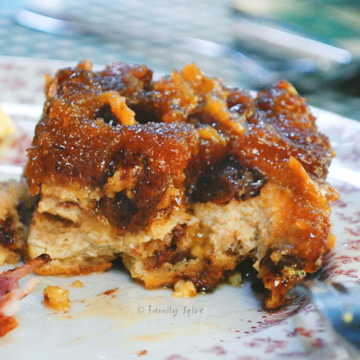 A slice of croissant bread pudding on a plate