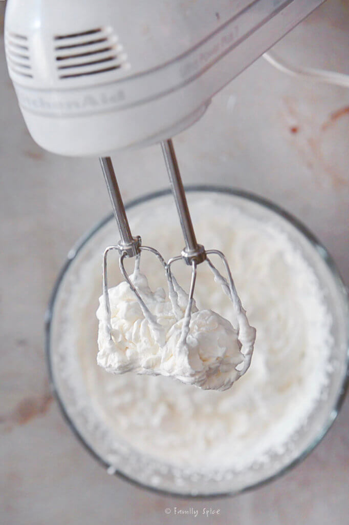 Heavy cream whipped to stiff peaks on hand mixer beaters