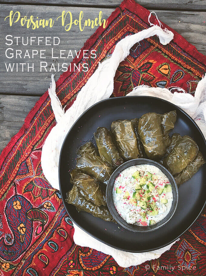 Persian dolmeh comes in all varieties of stuffing and vessels. These stuffed grape leaves with raisins are meatless and offer a a wonderful sweet and sour combination. - FamilySpice.com