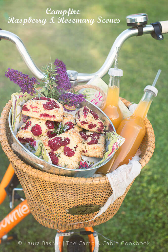 Raspberry scones and bottles of strawberry lemonade in the front basket of a bicycle